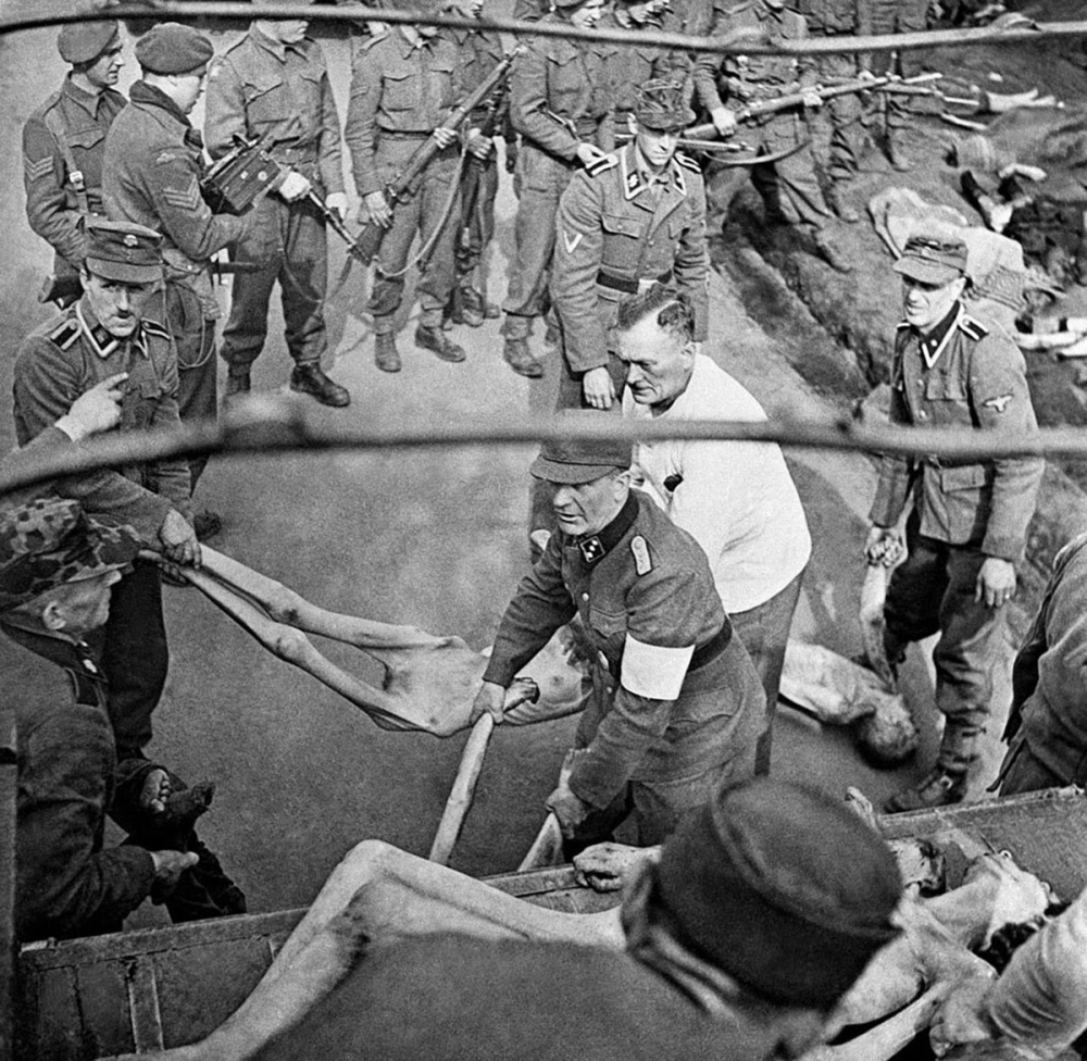 SS prison guards forced to load victims of Bergen-Belsen concentration camp into a trucks for burial, 1945